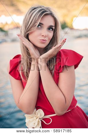Beautiful, Young Woman Sends An Air Kiss