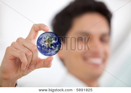 Business Man Holding The World