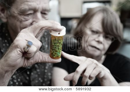 Senior Couple At Home With Prescription
