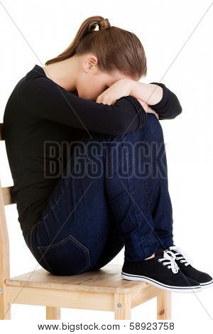 Sad teen girl heaving depression. Isolated on white