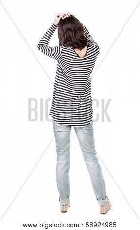 Back view of shocked woman in frock. girl hid his eyes behind his hands.  Rear view people collection.  backside view of person.  Isolated over white background.