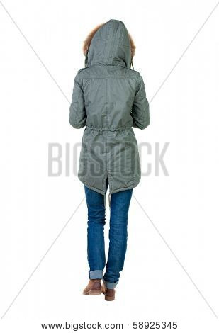 back view of walking  woman in winter jacket with hood. beautiful brunette girl in motion.  backside view of person.  Rear view people collection. Isolated over white background.