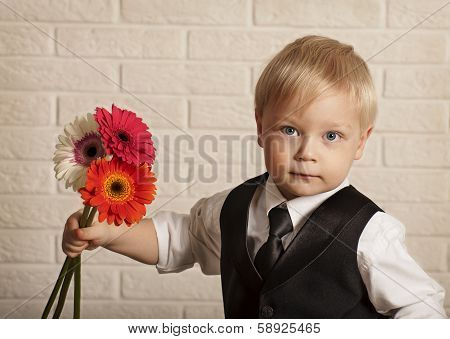 Young blond man in with bouquet flowers.