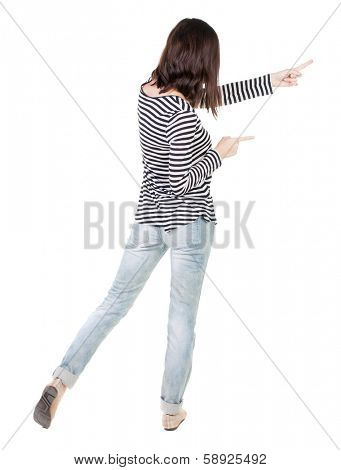 Back view of  pointing woman. beautiful brunette  girl in frock. Rear view people collection.  backside view of person.  Isolated over white background.