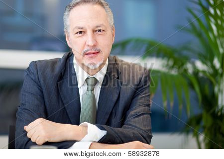 Senior manager at his desk in the office