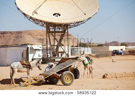 WADI HALFA, SUDAN - JANUARY 07,2010: Sudanese peasant repaires a cart  in border town Wadi Halfa. Sudan remains one of the least developed countries in the world.
