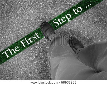 Man walking across a green line with words the first step to