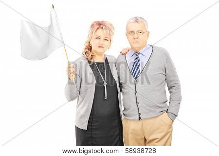 Middle aged couple waving a white flag, isolated on white background