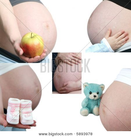 Stomach of the pregnant woman on a white background
