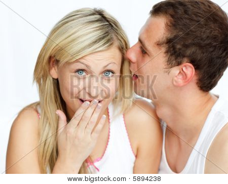 Man Whispering A Woman A Secret