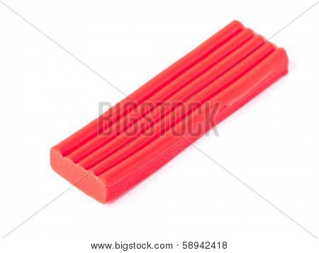 Single bar of plasticine isolated on white background