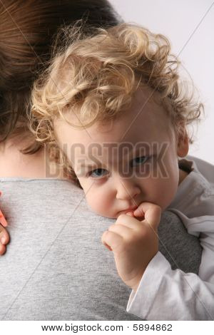 Kid on mothers hands.