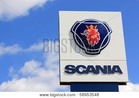Sign Scania Against Blue Sky With Some Clouds