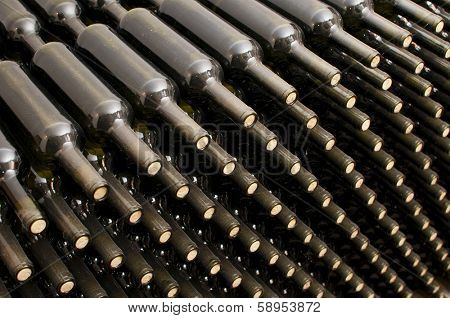 stacked wine bottles in the cellar