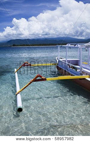 Boat on the blue lagoon of Gili Air, Indonesia