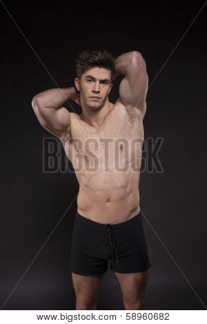 Fitness man on black background torso