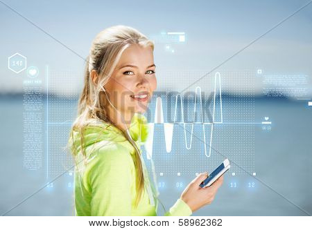 fitness and lifestyle concept - woman doing sports and listening to music outdoors