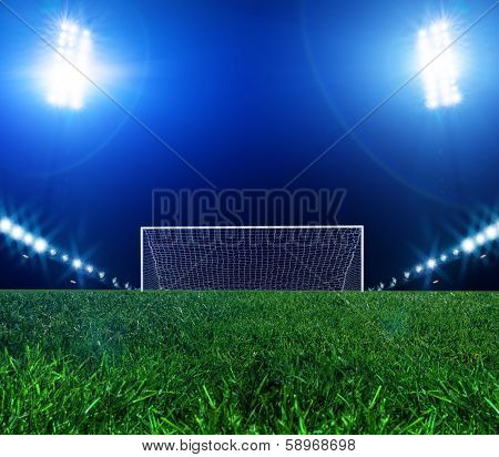 Stadium lights at night and the goal