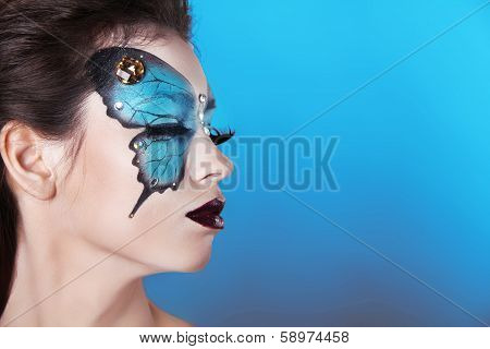 Face Art Portrait. Fashion Make Up. Butterfly Makeup On Face Beautiful Woman.