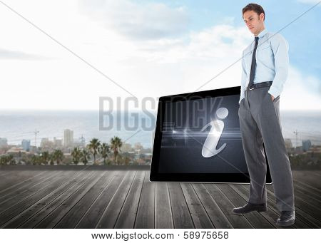 Serious businessman standing with hands in pockets against ocean scenic view