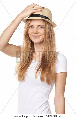Stylish casual young woman holding her hat cock
