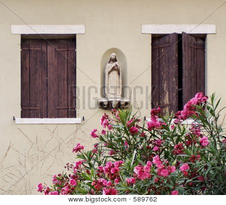Virgin Mary Statue With Flowers