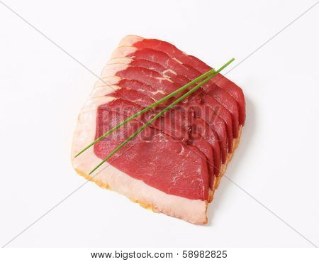 thin slices of duck breast decorated with chive