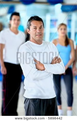 Gym Man In Front Of A Group