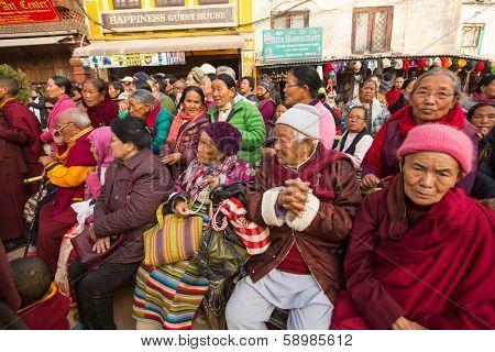 KHATMANDU, NEPAL - DEC 17: Unidentified Buddhist pilgrims near stupa Boudhanath during festive solemn Puja of H.H. Drubwang Padma Norbu Rinpoche's reincarnation's, Dec 17, 2013 in Khatmandu, Nepal.