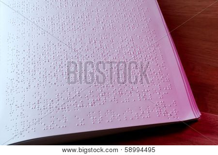 Book written in braille alphabet for blind people