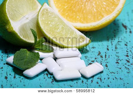 Chewing gums with fruit taste,   on color wooden background