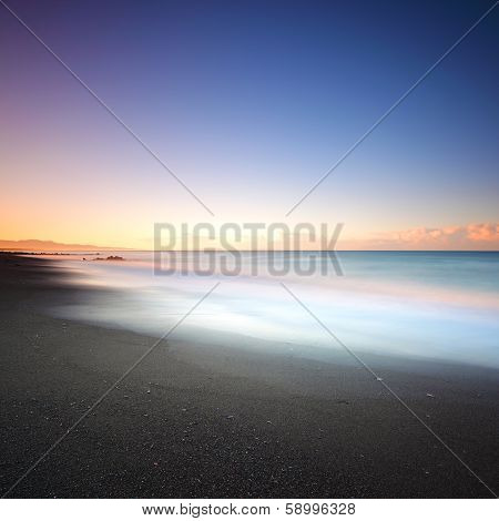 Beach Dark Sand And Sea On Morning. Tuscany Italy
