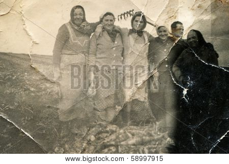 BIELSKO, POLAND, JANUARY 26, 1941 - Vintage photo of group of female farm workers in field