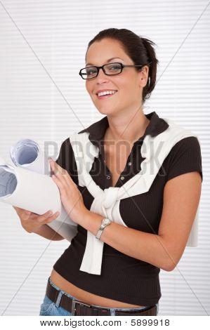 Smiling Female Architect Holding Plans