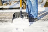 picture of snow shovel  - Man with a snow shovel on the sidewalk - JPG