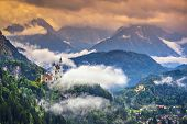 pic of bavarian alps  - Neuschwanstein Castle in the Bavarian Alps of Germany - JPG