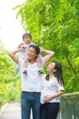 stock photo of father time  - Happy Asian family outdoor - JPG