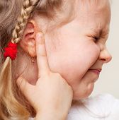 stock photo of suffering  - Child has a sore ear - JPG