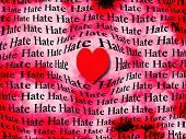 pic of hate  - Words of hate surrounded by large red heart symbolizing that love is more powerful than hate - JPG