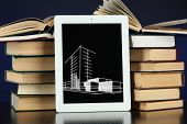 stock photo of sketch book  - Tablet with house sketch project and books - JPG