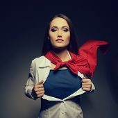 picture of chest  - Young pretty woman opening her shirt like a superhero - JPG