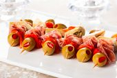 foto of artichoke hearts  - Antipasti skewers with olives - JPG