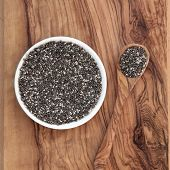 image of salvia  - Chia seed healthy super food over olive wood background - JPG