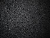 foto of darkness  - dark background texture of asphalt , 