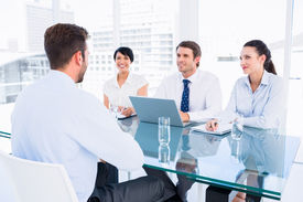 foto of half-dressed  - Recruiters checking the candidate during a job interview at office - JPG