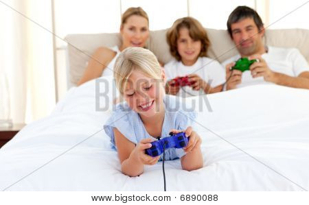 Cute Blond Child Playing Video Game With Her Family