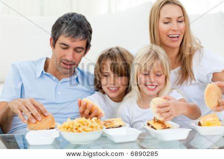 Loving Family Eating Hamburgers