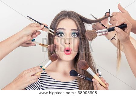 closeup of beautiful blond girl getting makeup done