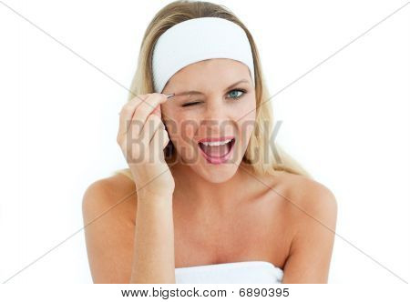 Young Woman Using Tweezers