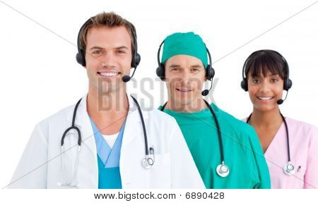 Smiling Medical Team Using Headsets